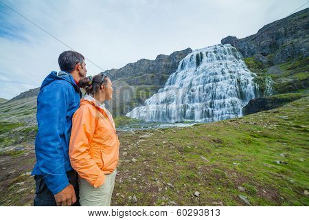 couple of tourists and Dynjandi. Iceland
