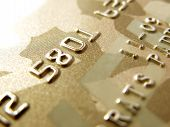 Numbers of golden credit card in very close up poster