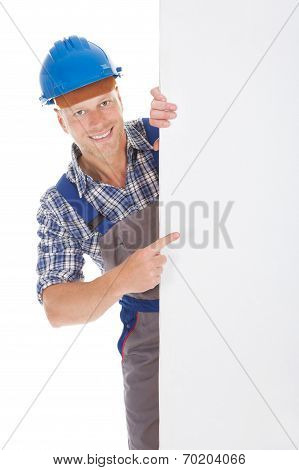 Confident Manual Worker Holding Billboard