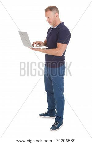 Man Using Laptop Over White Background