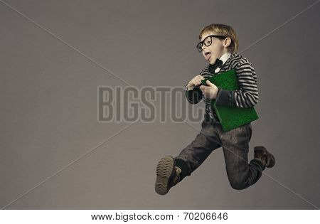 Child Running Back To School, Funny Kid Portrait, Jumping Smart Schoolboy With Glasses And Book