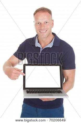 Man Pointing At Laptop Screen