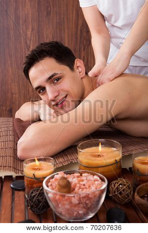 Man Receiving Shoulder Massage In Spa
