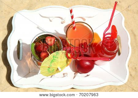Delicious cocktails on beach, close-up