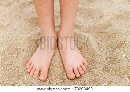poster of Bare feet of a young child in the sand