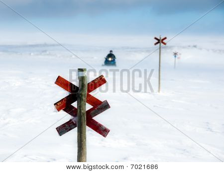 Snowmobile On Track In Winter Scene