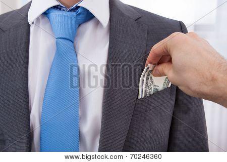 Hand Bribing Businessman