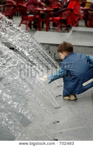Fountain And A Kid