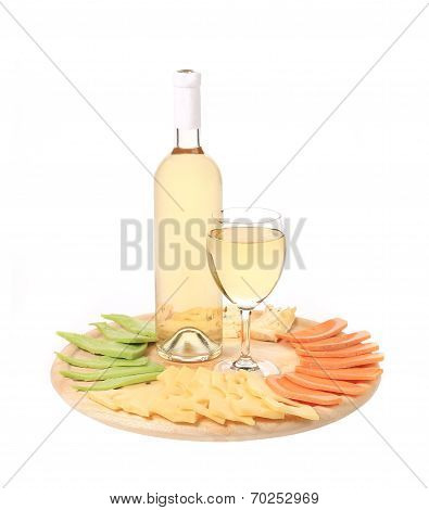 Bottle of chardonnay and cheese platter.