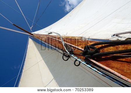 Old Wooden Mast With Crosspieces, Backstays,mainsail And Staysail, View From Deck Of Boat