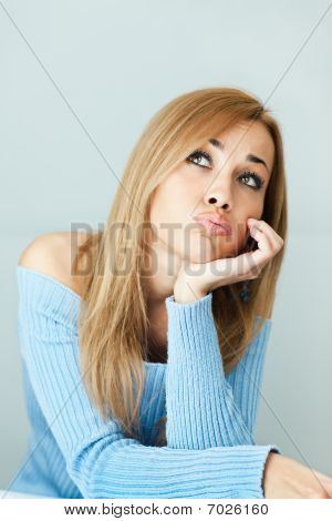 Bored Woman With Hand On Chin