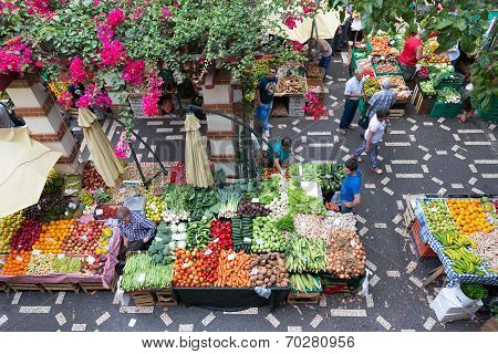 People Are Shopping At The Vegetable Market Of Madeira, Portugal