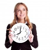 Portrait of happy smiling business woman holding in hands big clock isolated on white background, regular schedule, success concept poster