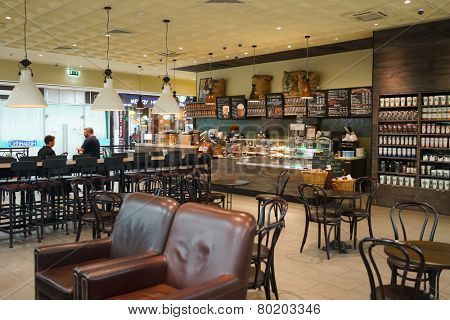 MOSCOW - SEP 24: Starbucks cafe interior in Sheremetyevo airport on September 24, 2014. Starbucks Corporation is an American global coffee company and coffeehouse chain based in Seattle, Washington