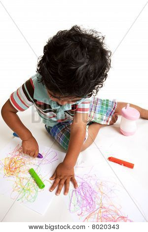 Toddler Producing Art Work with Crayons