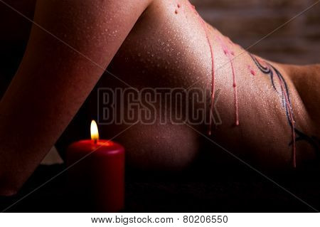 beautiful female body with red wax on it poster
