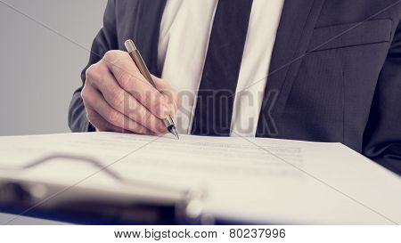 Retro Vintage Style Image Of A Businessman Signing A Contract