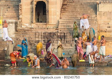 Pilgrims Bathing In The Ganges River In Varanasi, India