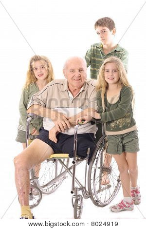 Grandchildren with handicap Grandfather in wheelchair