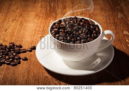 Still-life with a cup of coffee beans close up poster