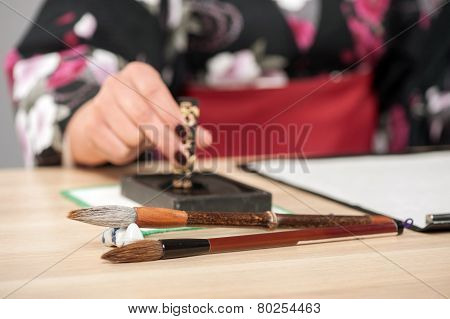 Traditional calligraphy on wooden table