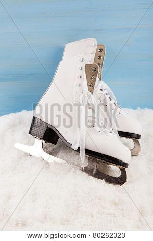 Ice skates on the snow