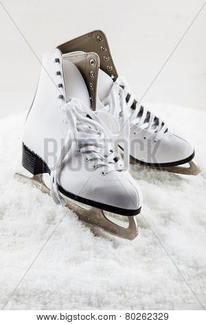 Ice skates with cap on the snow poster