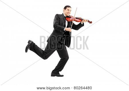 Full length portrait of a man running and playing a violin isolated on white background
