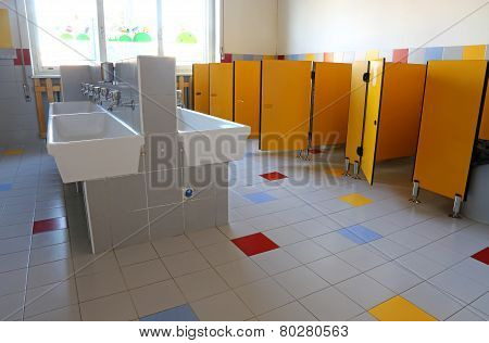 Bathroom Of The Nursery School With White Ceramic Sinks