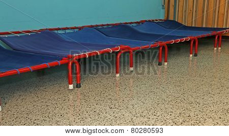 Small Beds Of A Dormitory Of Kindergarten Children