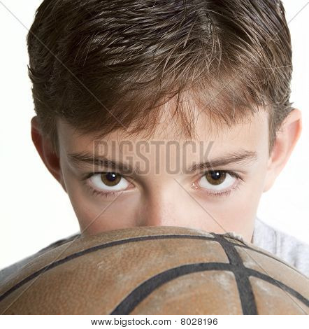 Youth Looking Over Basketball