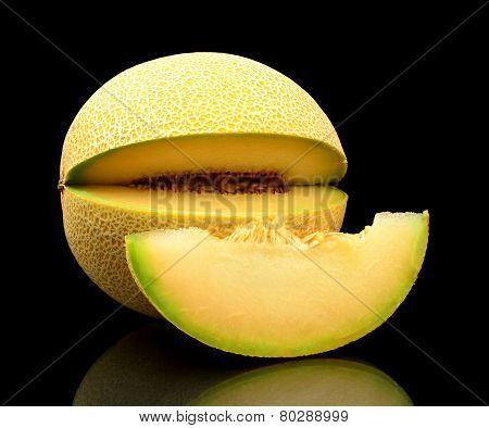 Melon Galia Notched With Slice Isolated Black In Studio