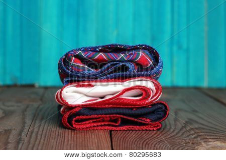Stack Of Women's Panties Lying On A Wooden Table
