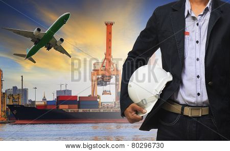 Manager Man Holding Safety Helmet Standing Against Ship And Container On Shipping Port And Cargo Pla