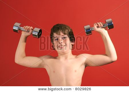 young kid pumping iron upclose
