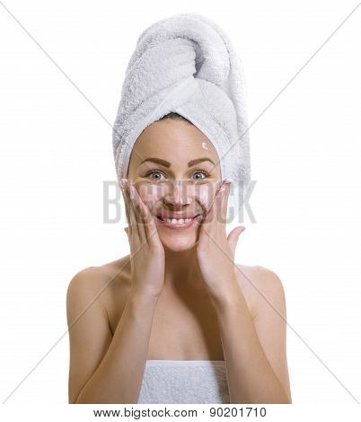 Expresive Female After Bathing Putting Cream Or Moisturize On His Face ,isolated On White