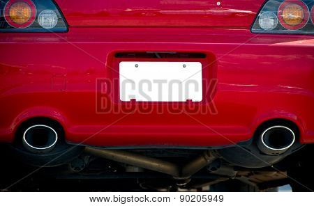 Blank License Plate On Red Car