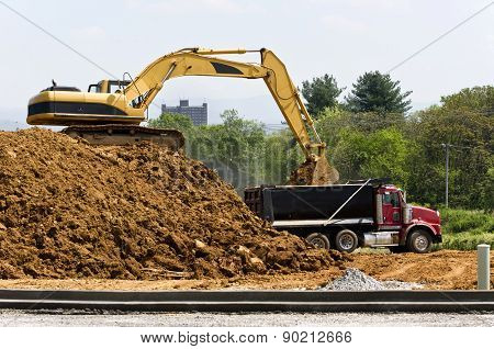 Construction Excavator And Dump Truck