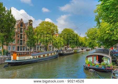 Houseboats on Amsterdam canal, Holland.
