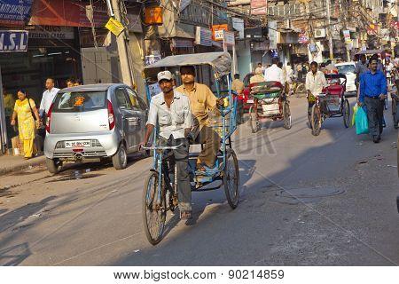 Rickshaw Rider Transports Passenger