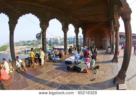 Group Of Worshipers Rest On Courtyard Of Jama Masjid Mosque In Delhi