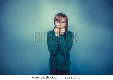 teenager boy with glasses lips blowing  antics emotions fists in