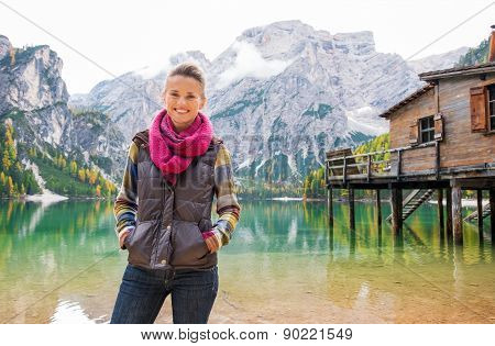 Woman Standing Smiling At Lake Bries In The Italian Dolomites