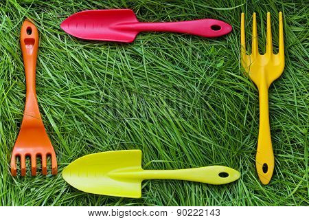 Set Of Gardening Tools On Grass