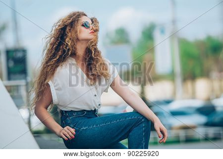 Beauty Girl Outdoors enjoying nature. Beautiful Teenage Model girl with long healthy blowing hair ru