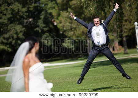 Happy Groom In Jump