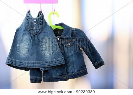 Fashion Baby  Denim Dress With  Jacket  Hanging On A Hanger