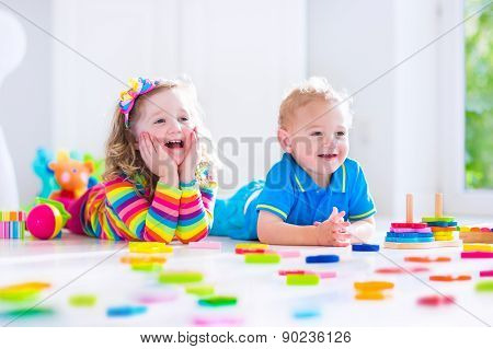 Children Playing With Wooden Toys