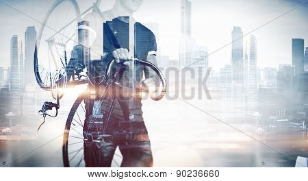 Man with a bicycle on modern background