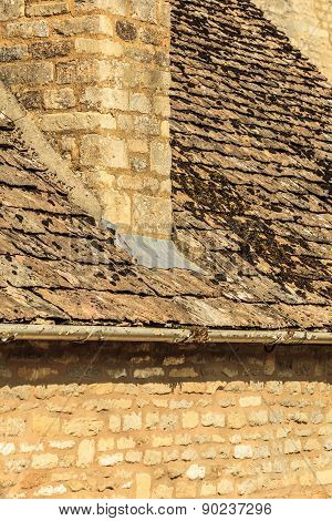 Old Stone House With Chimney Mossy Roof Tiles